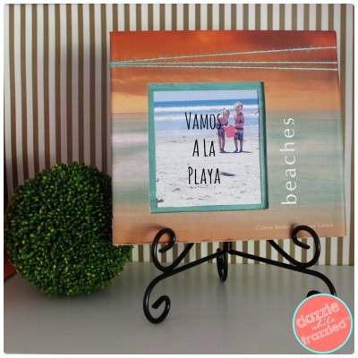 Turn thrift store hardcover coffee table book into wall photo frame.