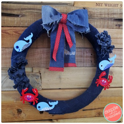 Reuse old jeans and wooden nautical cutouts for DIY nautical ocean wreath decoration.