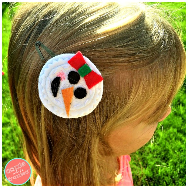 Cute snowman snowgirl hair barrette for girls made from felt. Easy winter Christmas kids craft.