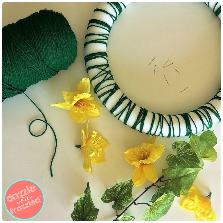 DIY springtime green yarn wreath with faux daffodils