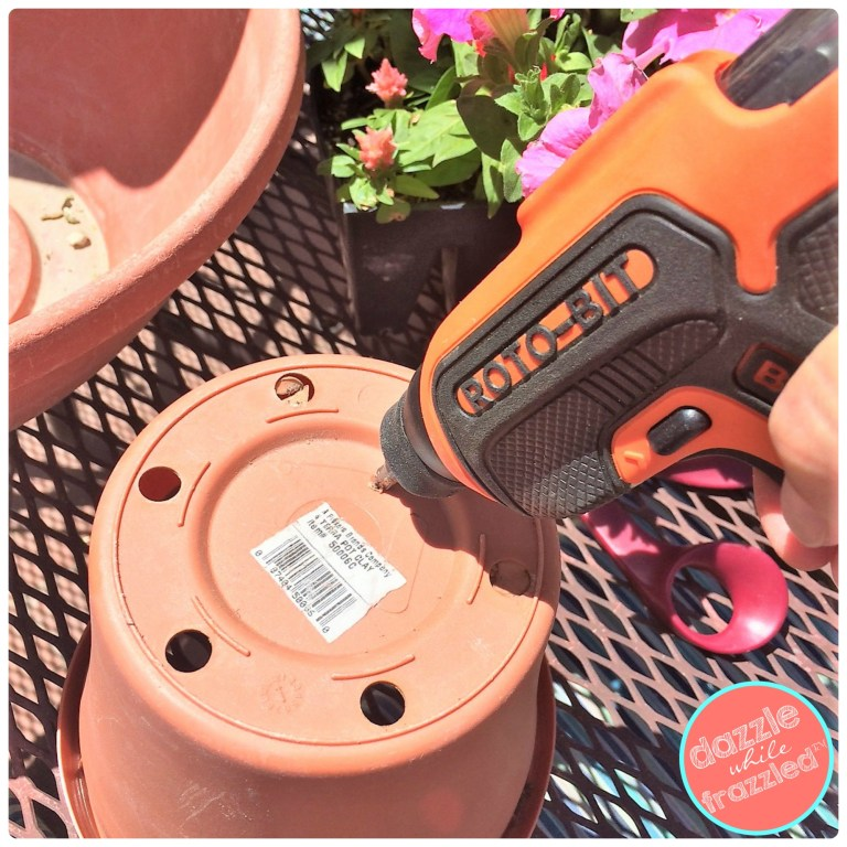 Use roto bit power drill to make a hole in the bottom of a plastic terra cotta flower pot.