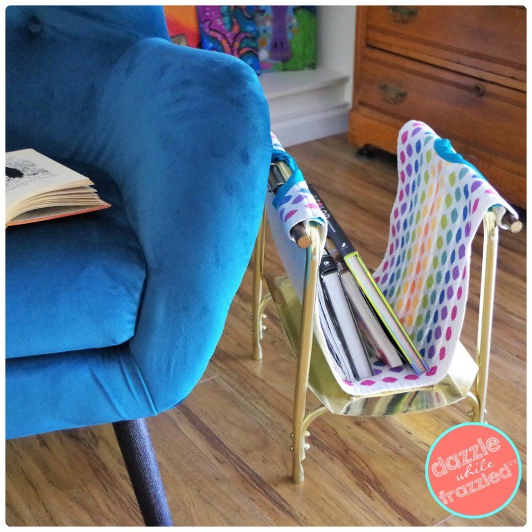 Use new fabric to make DIY magazine rack with removable liner to organize books and magazines.