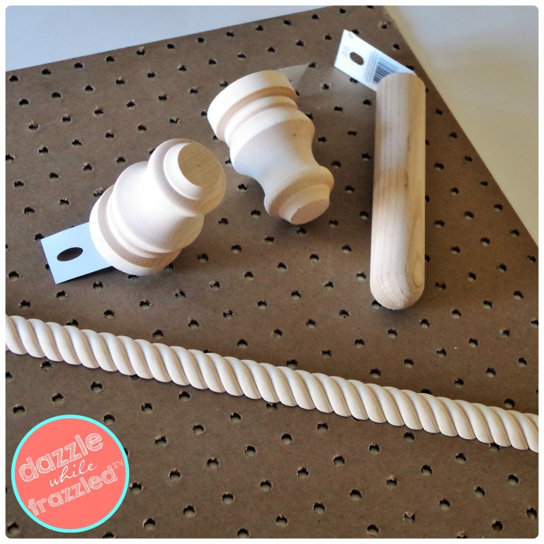 DIY girls hair accessories organizer using wood peg board and finials to hang on the wall.