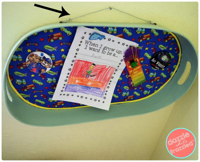 Drill holes through a metal serving tray to make a DIY wall-mounted magnet board for a kids room.