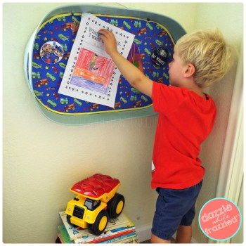 Repurpose an old serving tray into a painted and fabric-covered magnet board for a kids bedroom.
