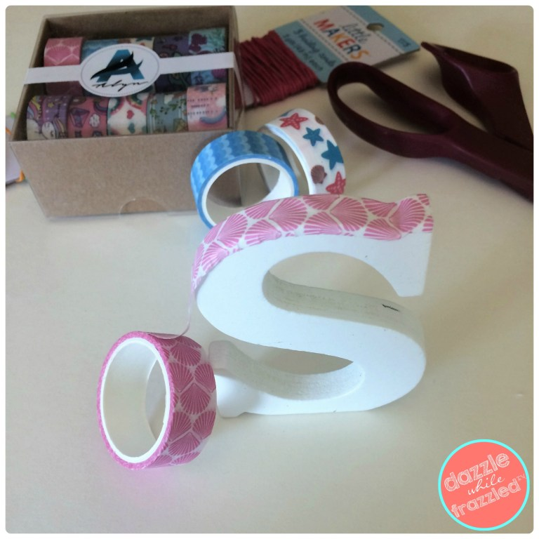 Outline a small wooden letter with washi tape for a DIY purse or backpack tag.
