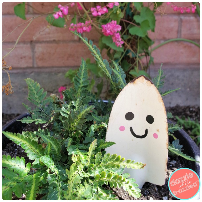 Cute Halloween ghost DIY plant stake from old gardening shovel.