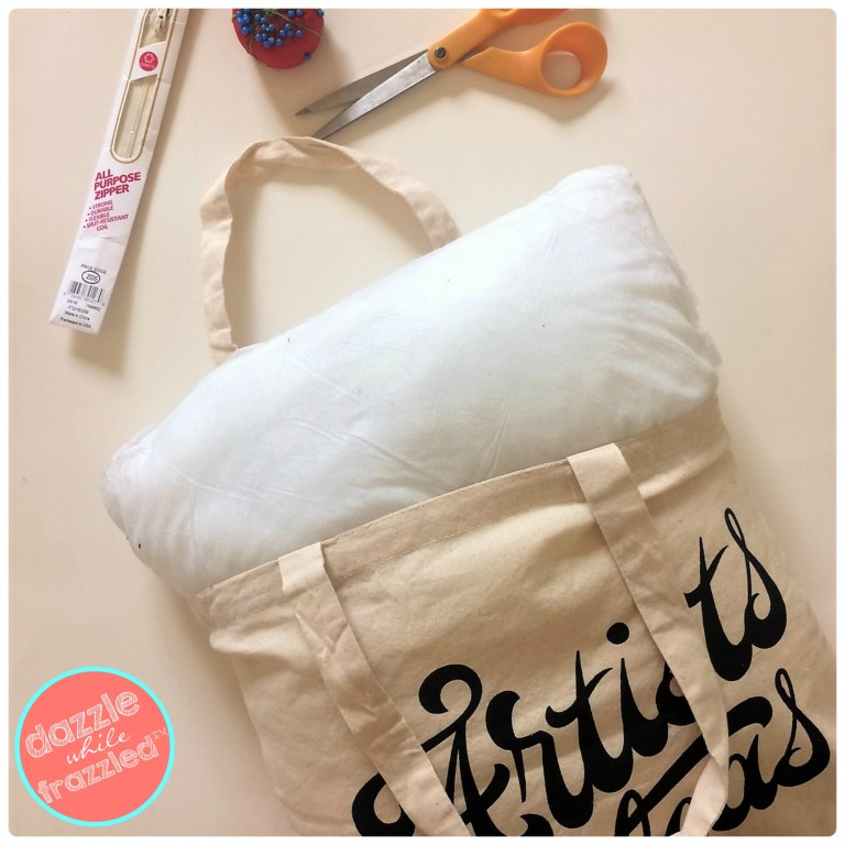 Insert a pillow form into a tote bag to make a DIY throw pillow for home decoration.