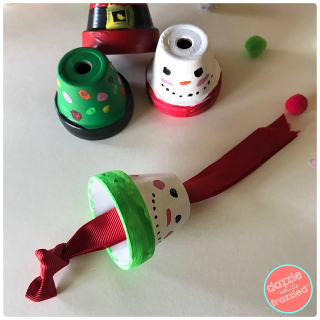 Insert grosgrain ribbon through clay flower pot to hang as Christmas tree ornament or to attach to present wrapping.