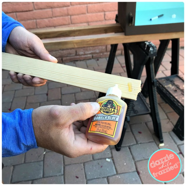 Use original Gorilla Glue to secure polycarbonate wood closures (gingerbread trim) to top of plywood roof on DIY Little Free Library.