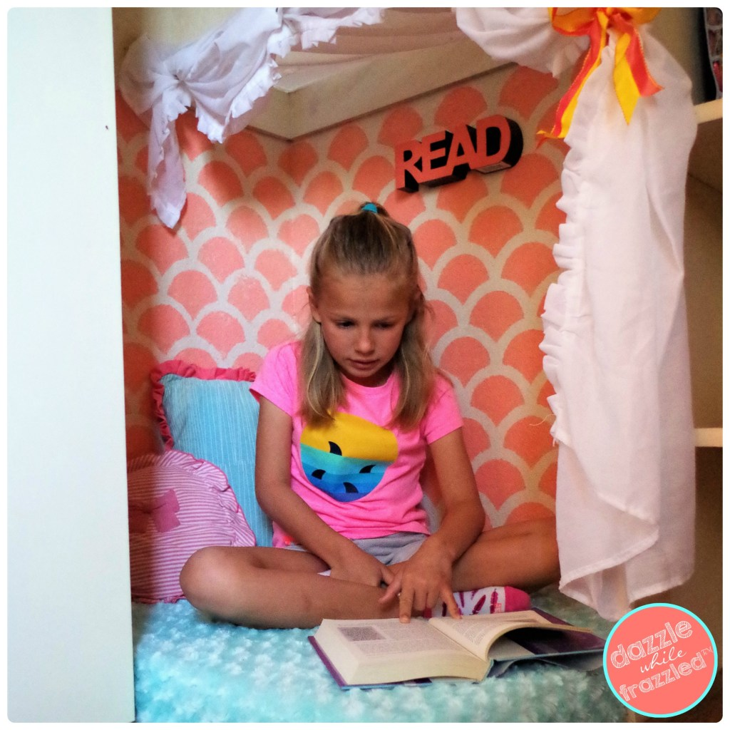 Get the kids reading with cute comfy DIY reading nook in corner of empty closet.