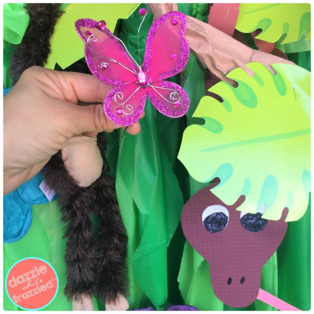 Add butterflies, tropical leaves, snakes and monkeys to DIY jungle-themed Halloween trunk or treat for minivan.