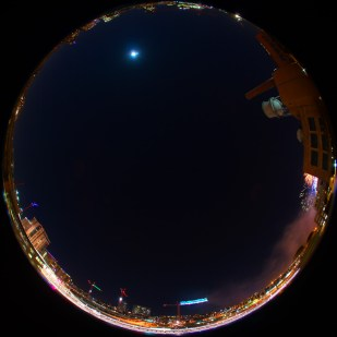 #2484 - timelapse shot using a fisheye lens from a roof top in Denver, CO. Phosphorescent starlings come in to roost on the crane