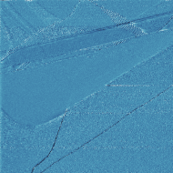 HOPG surface after cleaving, showing what appears to be a moiré pattern at the top right. Those small bumps are too large to be atoms. Tunneling current image acquired in constant current mode.