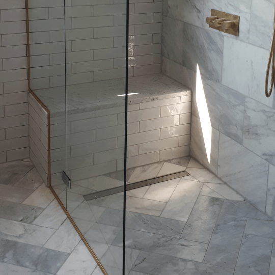 Bespoke Glass Shower Enclosure with seat cut out