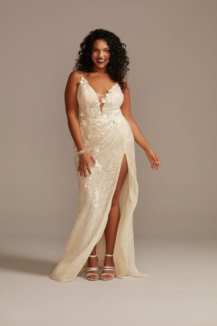 Bride wears beaded plunge wedding dress with a high slit