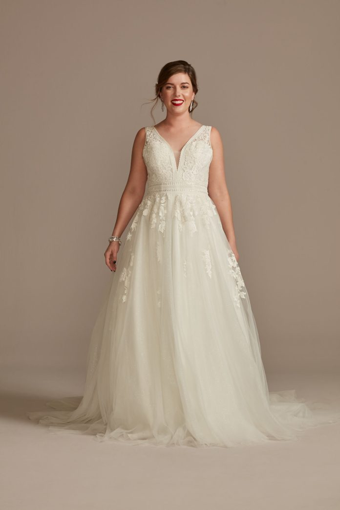 Bride wears ethereal embroidered wedding dress with v-neckline and tulle skirt