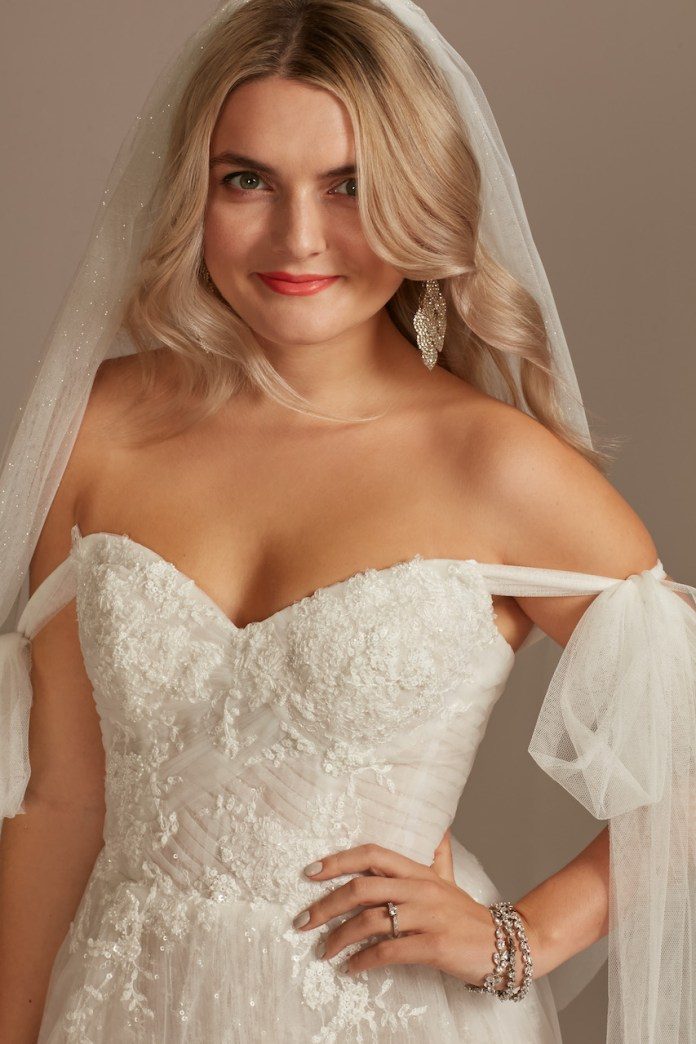 Bride wearing convertible strap tulle bodysuit wedding dress