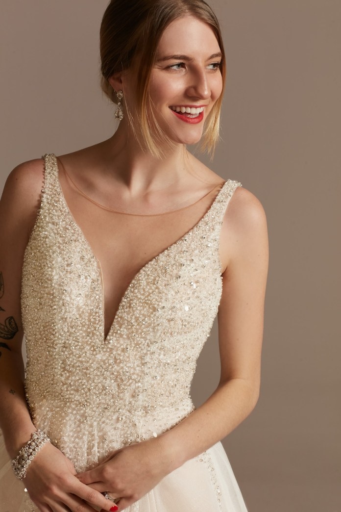 Bride Wears Beaded Plunge Illusion Bodysuit Wedding Dress