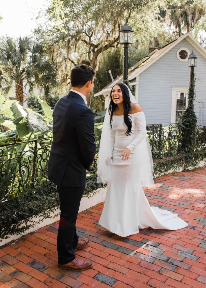 The bride and groom look at their intimate and romantic wedding in Florida first
