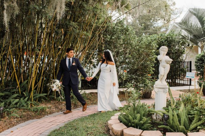 The bride and groom are out for a walk at their intimate and romantic wedding in Florida