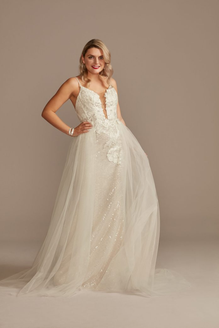 Bride wears sequin appliqué essential wedding dress with detachable train