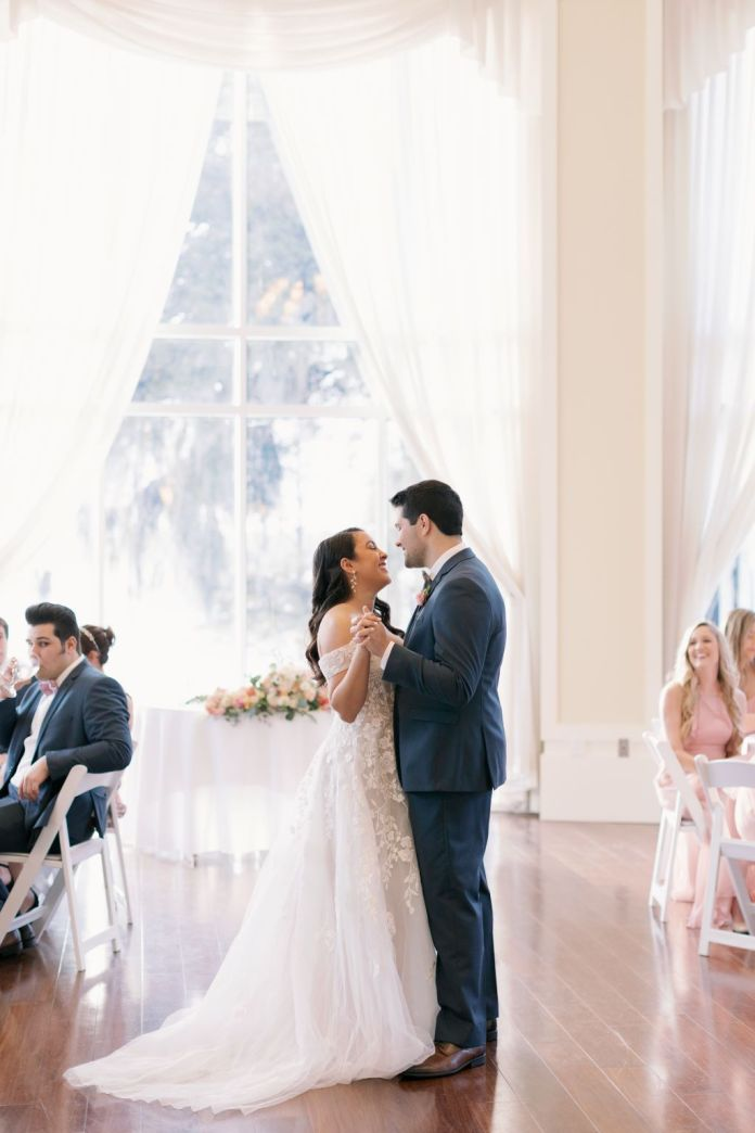 Bride and groom dance to the first dance song