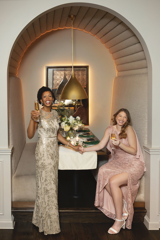 two moms are having a wedding reception in formal wedding attire