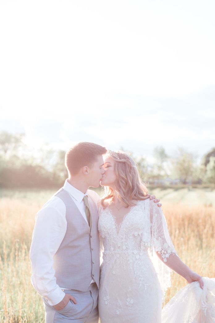 Bride and groom kiss at the golden hour