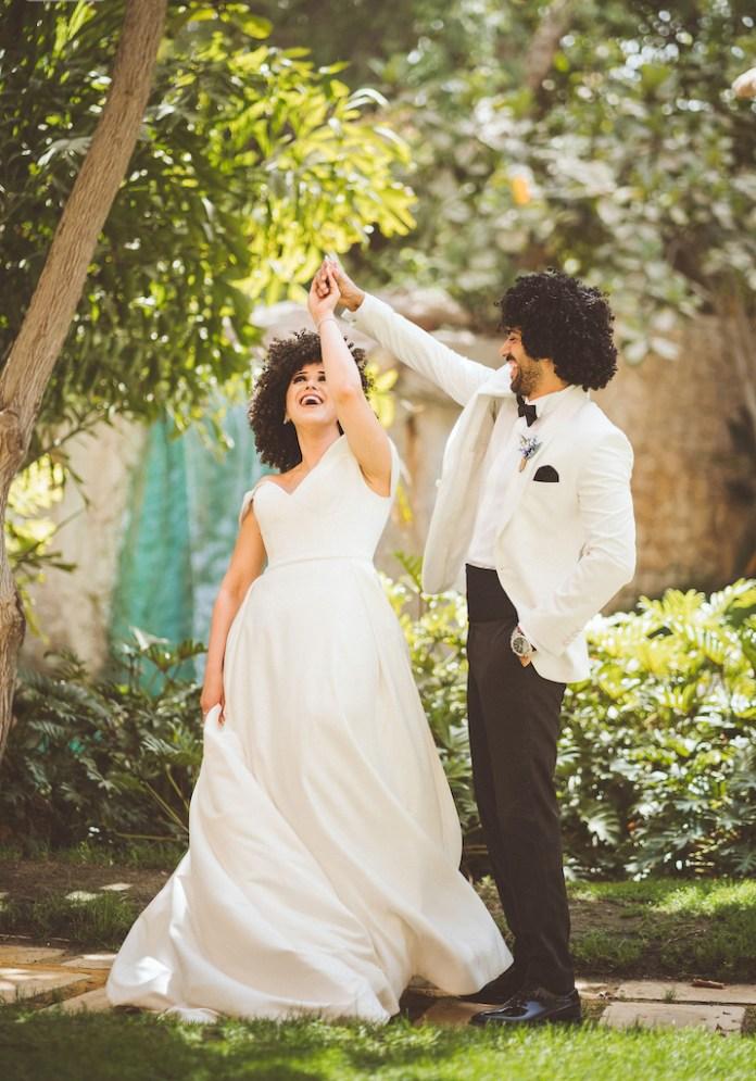 groom spins bride spinning