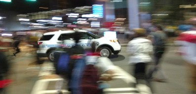 8:36pm: People threw metal and flower pots and other debris at a police vehicle that was trying to leave, just after the protester was shot. (David Boraks/WFAE)
