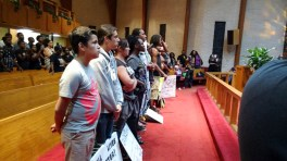 8:00pm: One group of protesters marched from Marshall Park to Little Rock AME Zion Church, to hear speeches of unity. (David Boraks/WFAE)