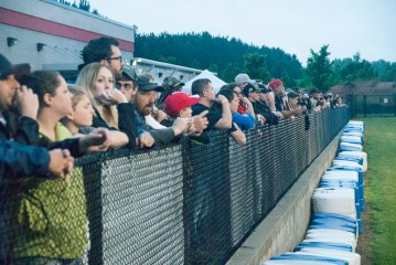 Fans lined up on the fence to watch. (David Boraks photo)