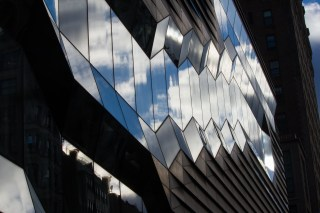 The sky reflecting in the facade of the New School.