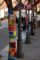 street tree that have been yarn bombed with knitted and crochet squares