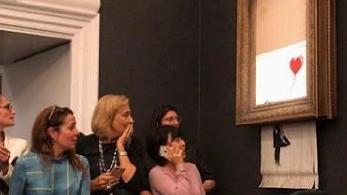 Banksy Painting Self-Destructs Moments After Being Sold for $1.4 Million