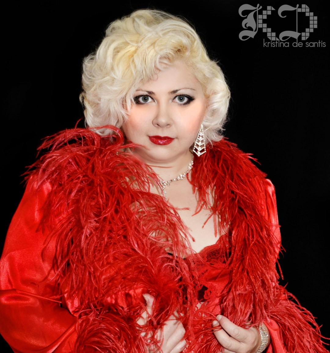 Diva Darling in red feathered robe