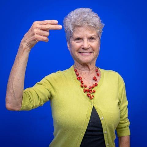 """Portrait of Janie Golighty, fingerspelling """"H"""""""