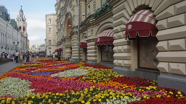 Flower garden in front of a building.