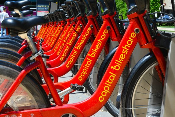 Line of red capital bikeshare bikes on a rack
