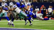 Dallas Cowboys running back Ezekiel Elliott (21) leaps into the end zone after getting past New York Giants cornerback Dominique Rodgers-Cromartie (41) and Nat Berhe (29) for his first career touchdown in the second half of an NFL football game, Sunday Sept. 11, 2016, in Arlington, Texas. (AP Photo/Ron Jenkins)