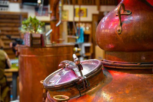 Close-up of copper distillation equipment at Duval Distillery