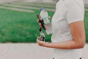 walking with water bottle, phone, keys