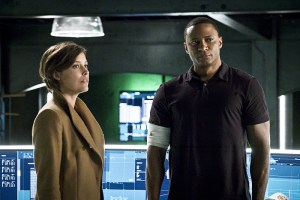 """Arrow -- """"A.W.O.L."""" -- Image AR411A_0173b.jpg -- Pictured (L-R): Audrey Marie Anderson as Lyla Michaels and David Ramsey as John Diggle -- Photo: Liane Hentscher/ The CW -- © 2016 The CW Network, LLC. All Rights Reserved."""