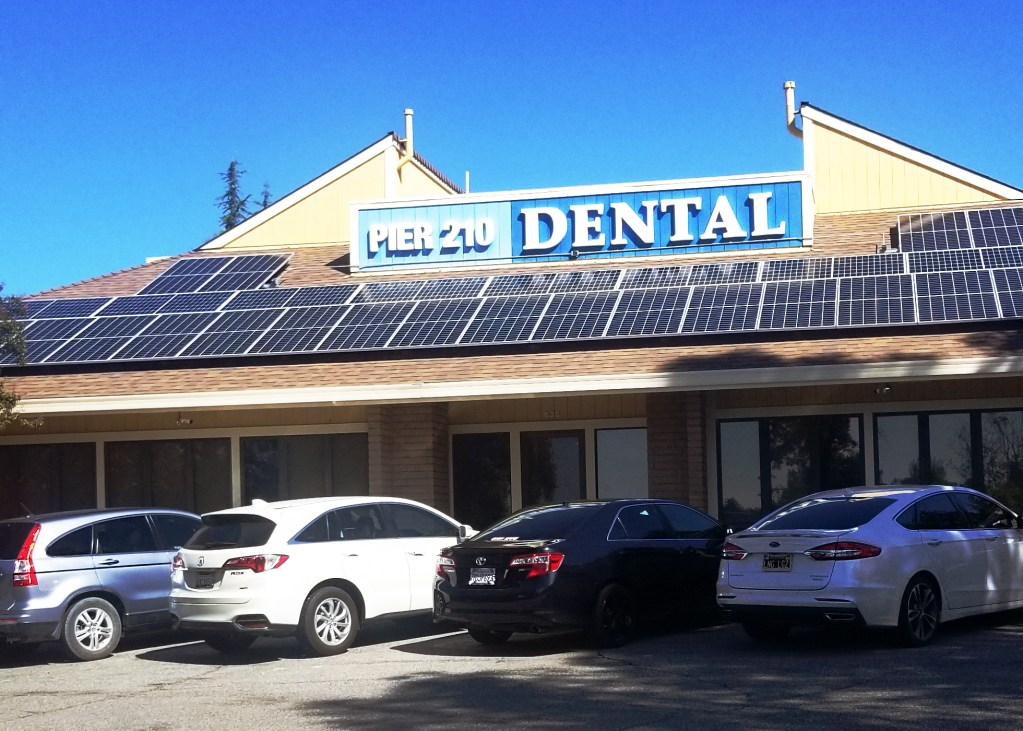 Solar panels installed on the roof of Pier 210 Dental provide all the electricity they need to operate their busy practice.