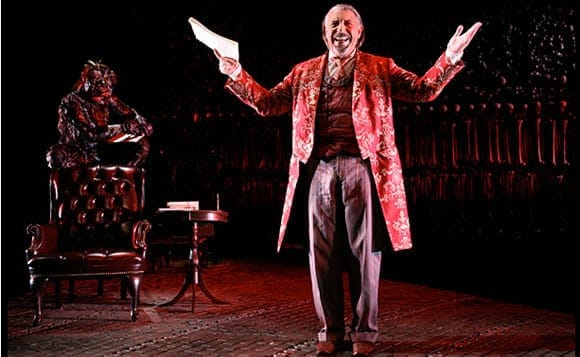 Max McLean as Screwtape with unspecified actress as Toadpipe in background .  (Photo: Gerry Goodstein)