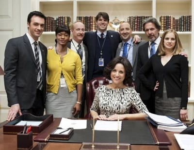 The cast of Veep: (seated) Julia Louis-Drefus.  (l-r) Reid Scott, Sufe Bradshaw, Matt Walsh, Timothy C. Simons, Tony Hale, Gary Cole and Anna Clumsky. (Photo: HBO)
