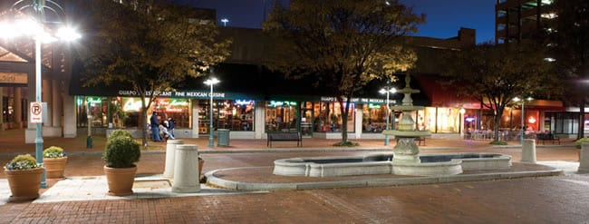 Shops and restaurants line the main street through Shirlington Village in Arlington, VA leading to Signature Theatre at its end