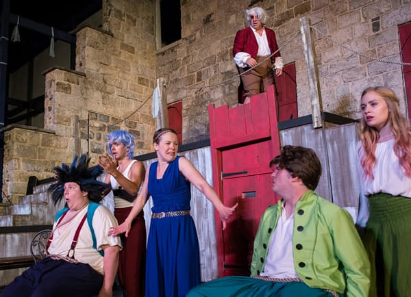 (top) Tim Bintrim as Dr. Pinch,  (l-r) Bobby Henneberg as Dromio, Billy Saunders as waiter, Mary Myers as Adriana, Robby Rose as Antipholus  and Ceili Lang as waitress. Photo by Teresa Castracane.