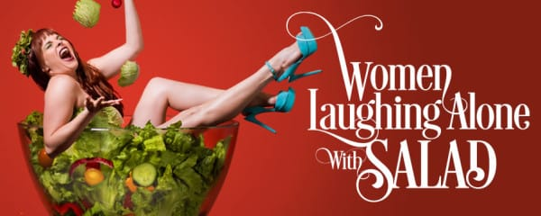 women laughing alone with salad comedy